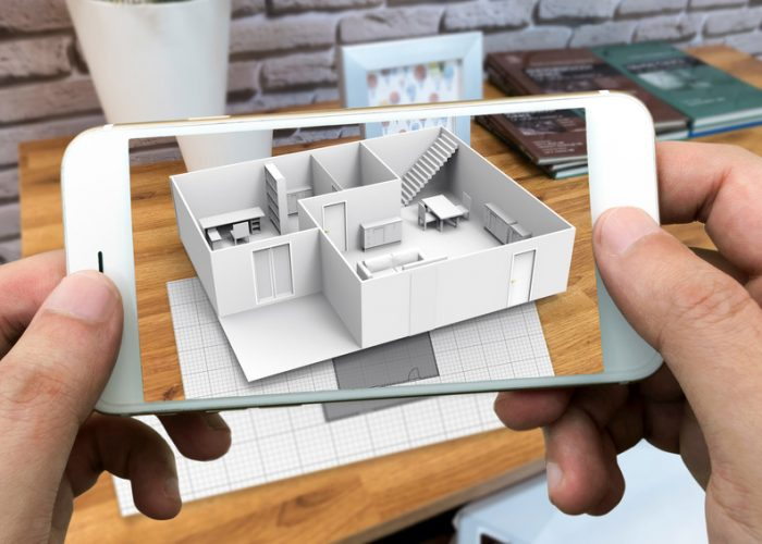 Augmented reality marketing concept for architecture. Hand holdi